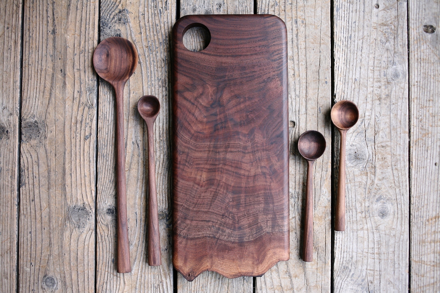 Hand carved spoons with live edge cutting board.