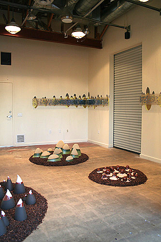 Wonder Row, 2009 (wall) & Victory Hills, 2009 (floor). ceramic, acrylic, latex & ceramic, cocoa shells