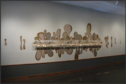 Growing in the Grit, 2008. ceramic, acrylic, latex.  50x175x3