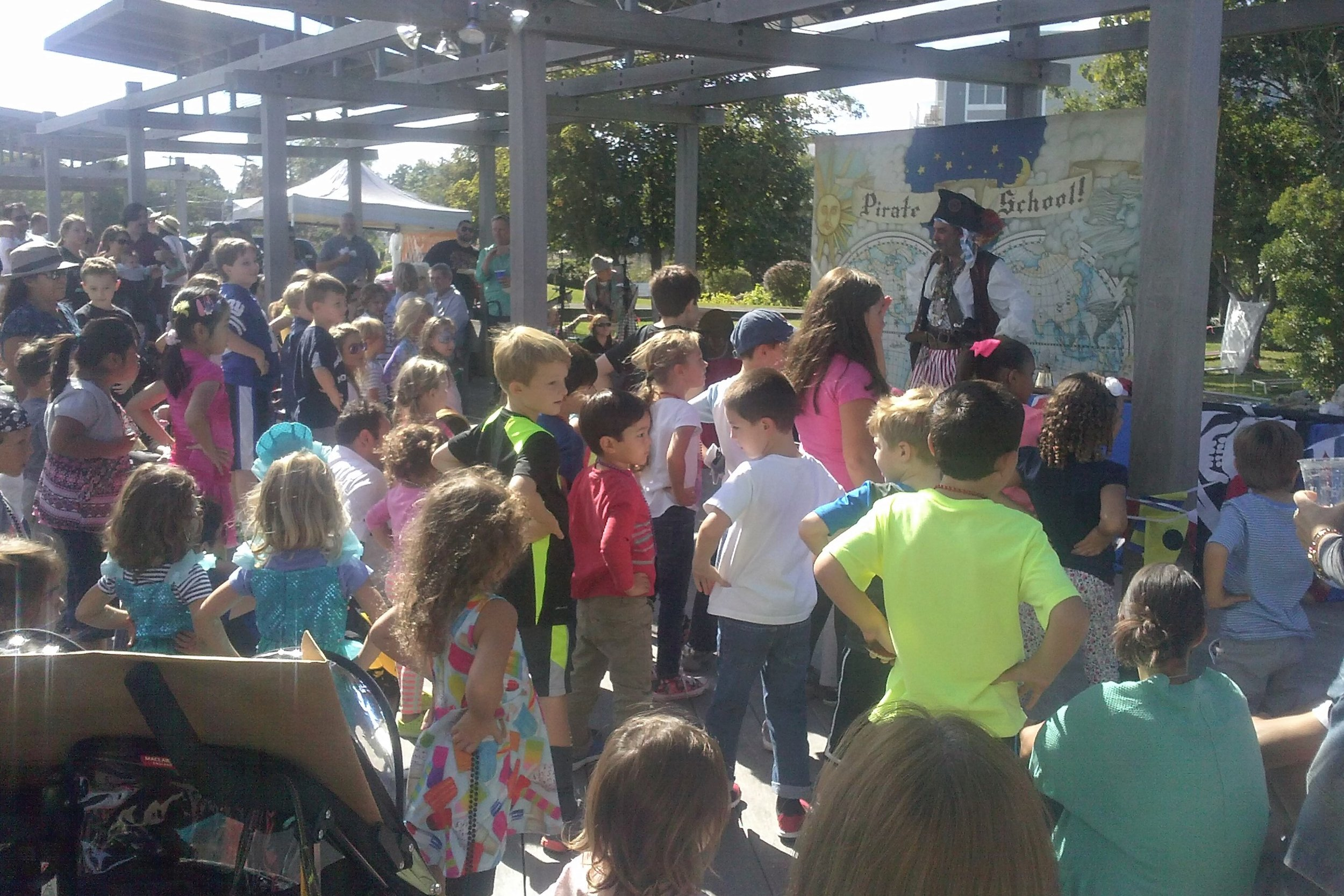 Pirate School Feet wide on the deck Hands on your hips Arrrr like a pirate Gport MarFest 2016.jpg