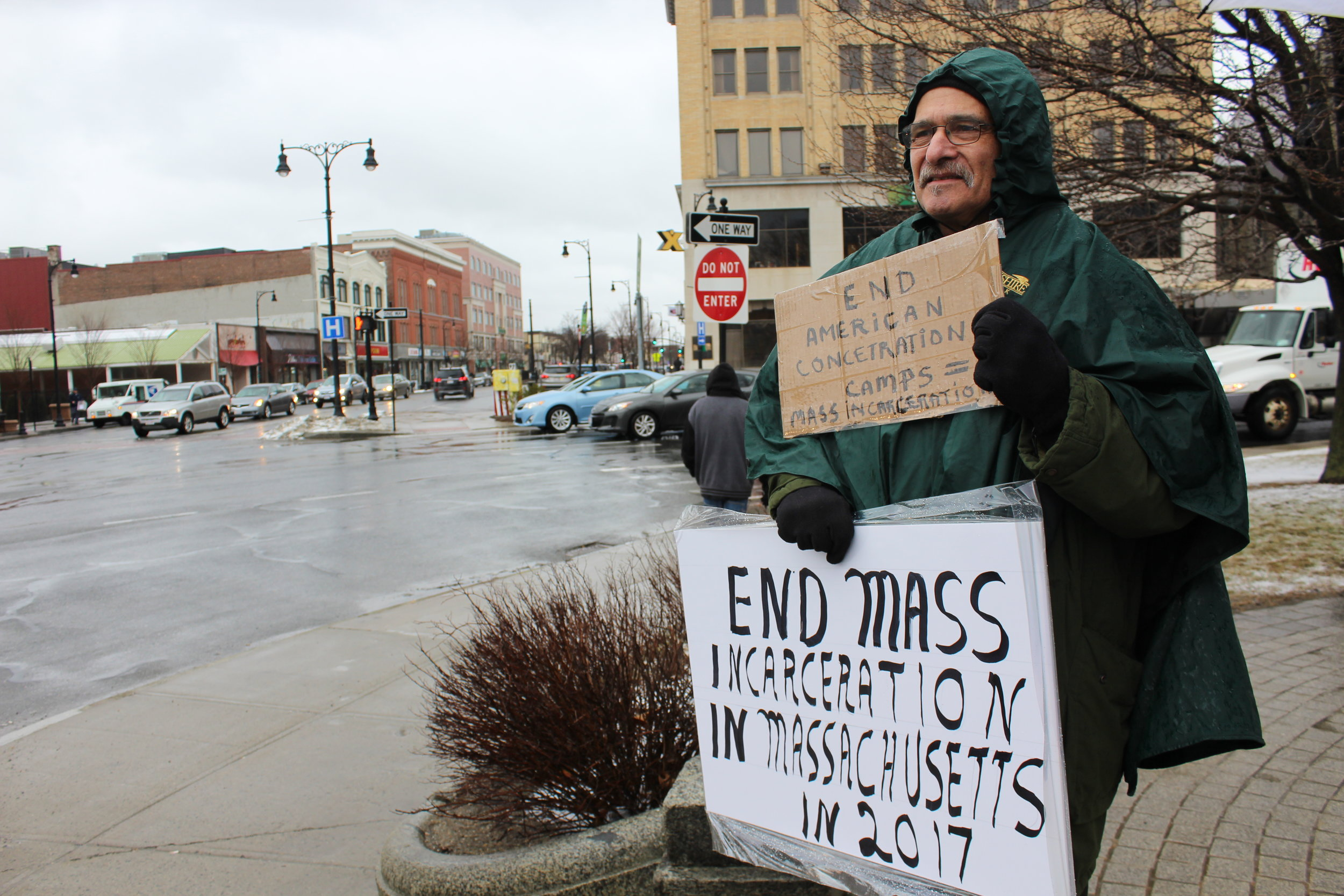 "Lenny Kates holds a sign that reads, ""End American Concentration Camps. Camps = Mass Incarceration,"" at rally protesting the U.S. criminal justice system in Pittsfield's Park Square March 31."