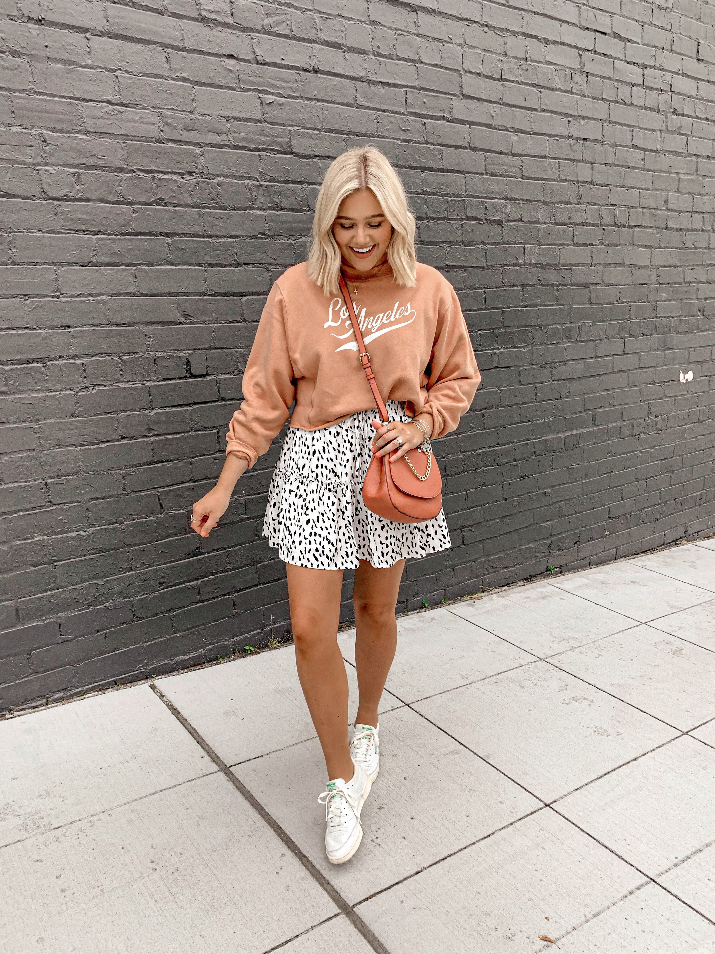 Bre Sheppard White Reebok Sneakers and Skirt