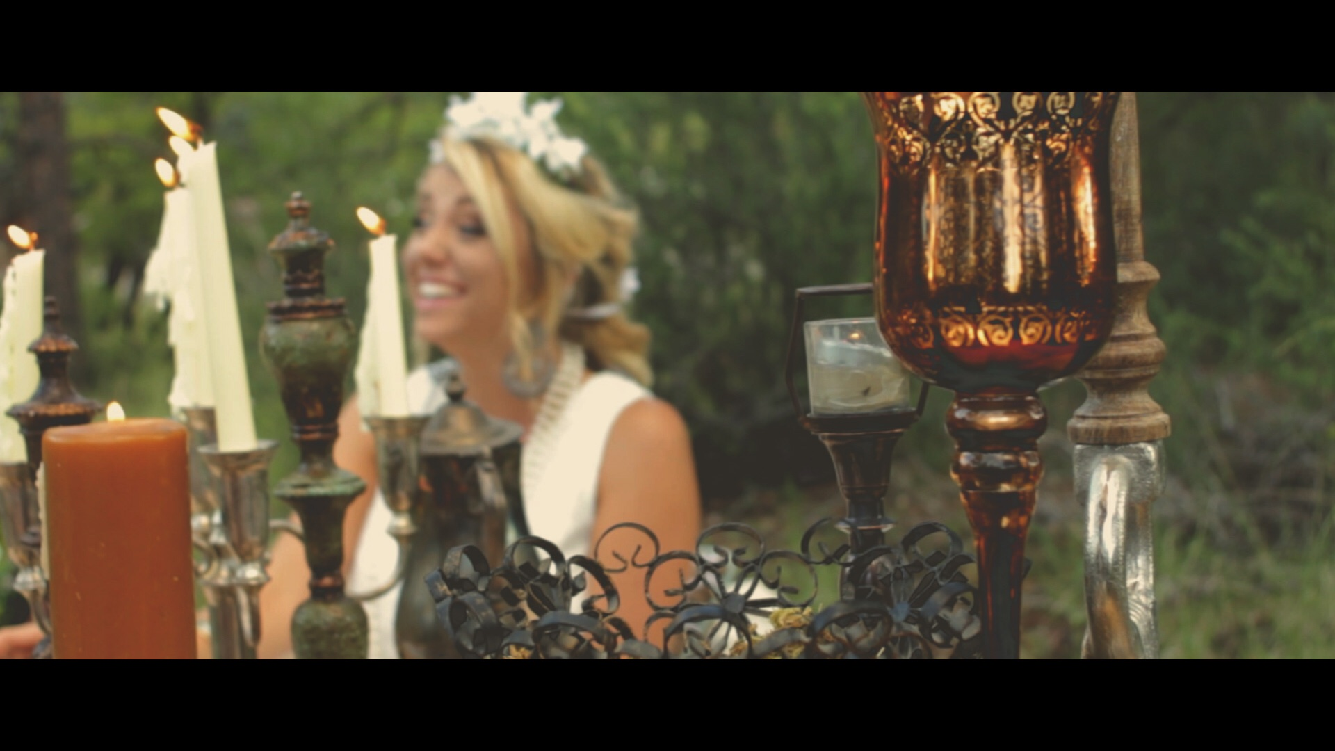 The details are the emphasis of this shot. The bride on the background keeps the image interesting.