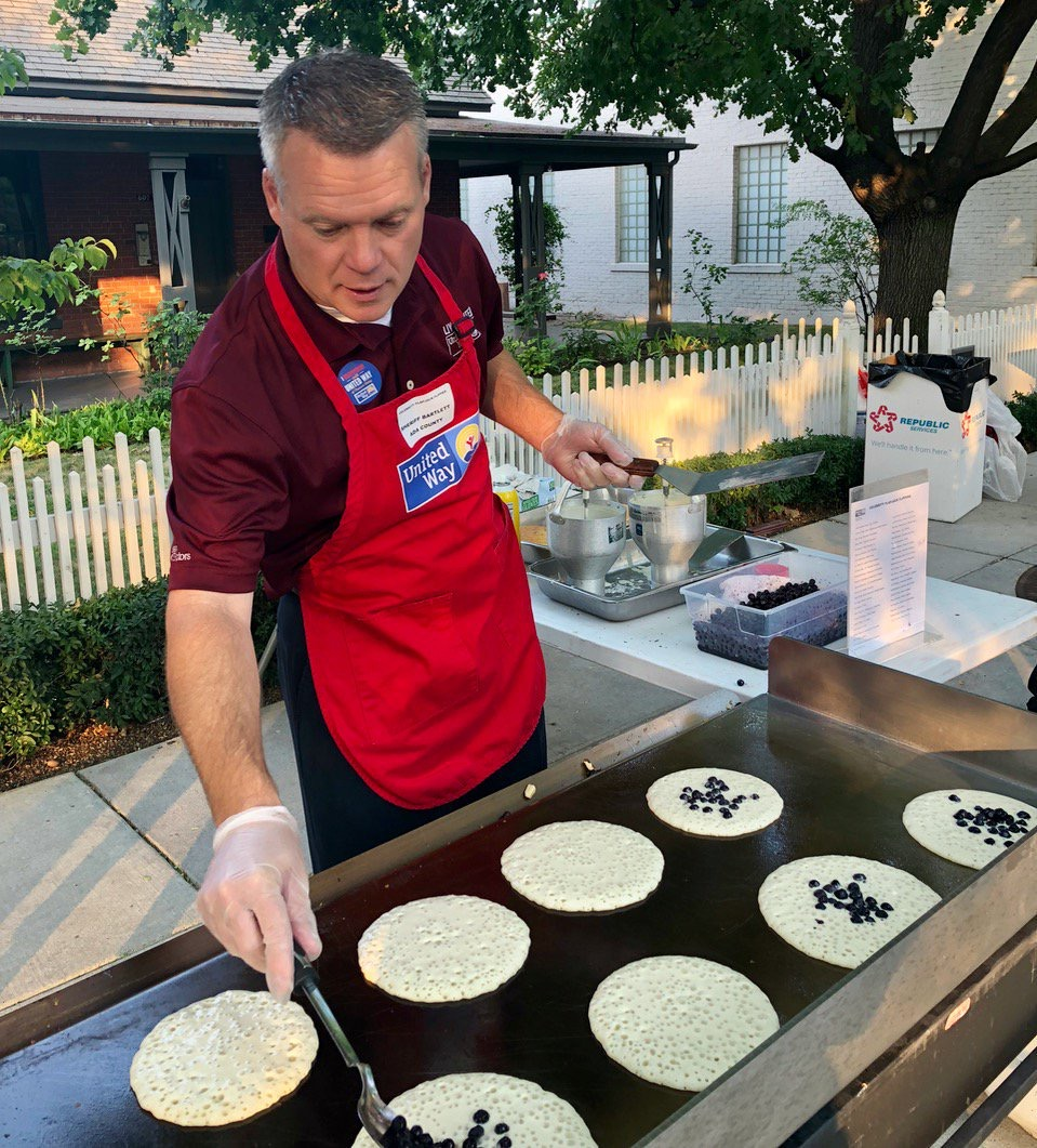 Sheriff Bartlett flips pancakes at the annual United Way event. He sits on the board of directors for the nonprofit organization.