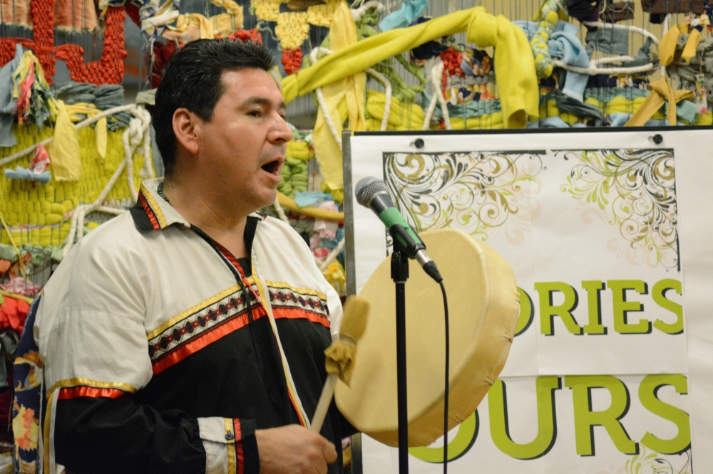 Jason Rocky Carter performing a traditional drum song before sharing his story. Photo by Sean Decory.