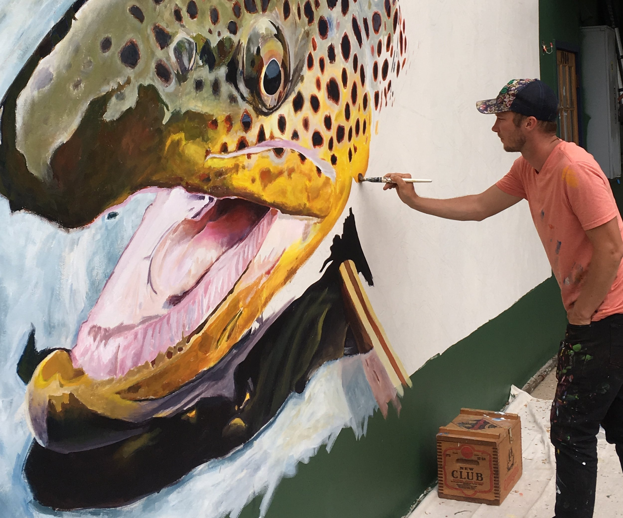 Remington painting a mural in Boulder, CO, May 2018.