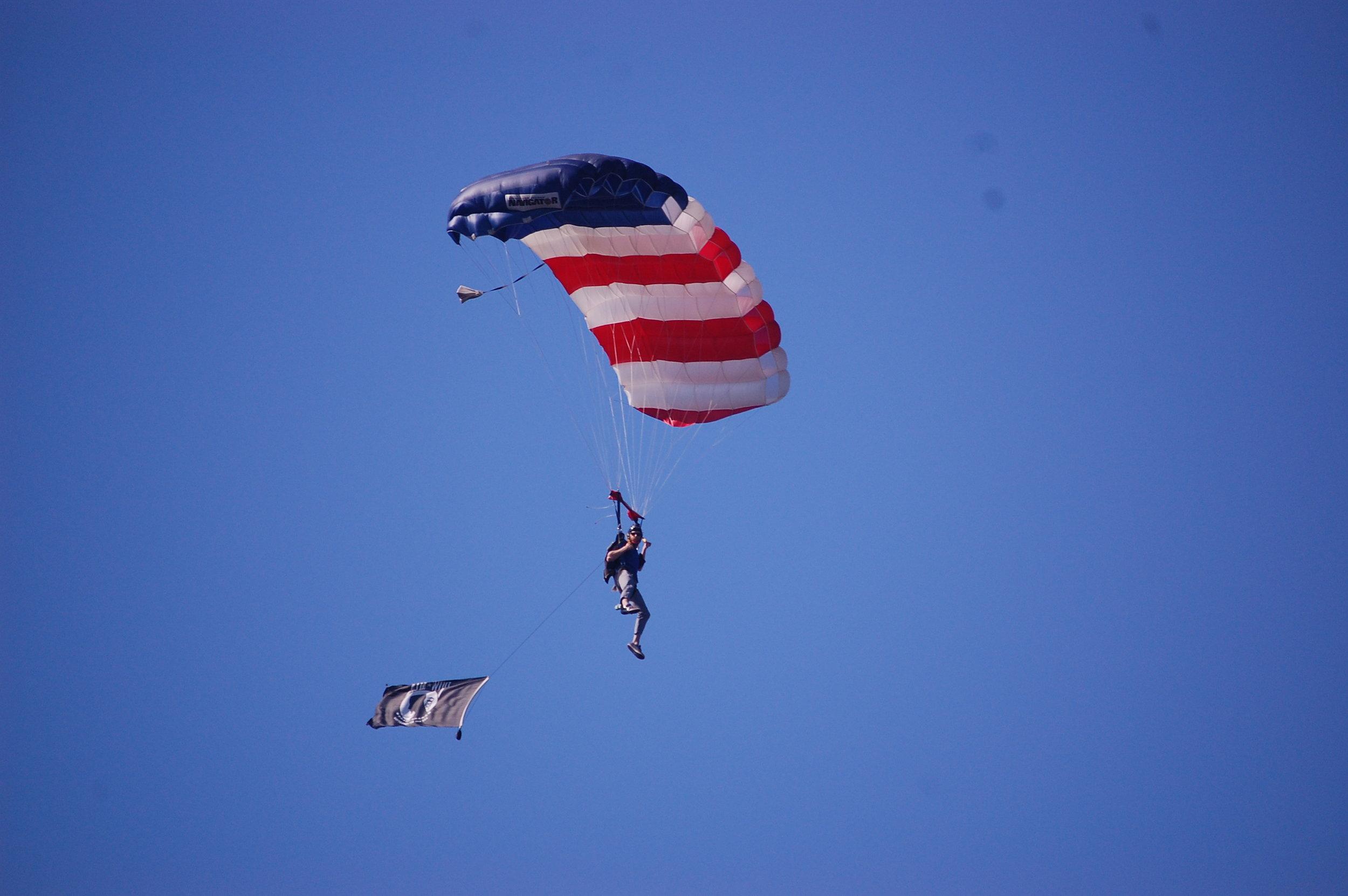 Cliff with the POW flag.JPG