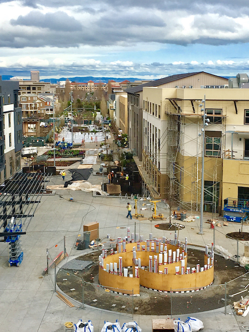 """Bay Meadows' Town Square under construction, with Hein's """"Mirror Labyrinth NY – for California"""" being installed in the foreground."""