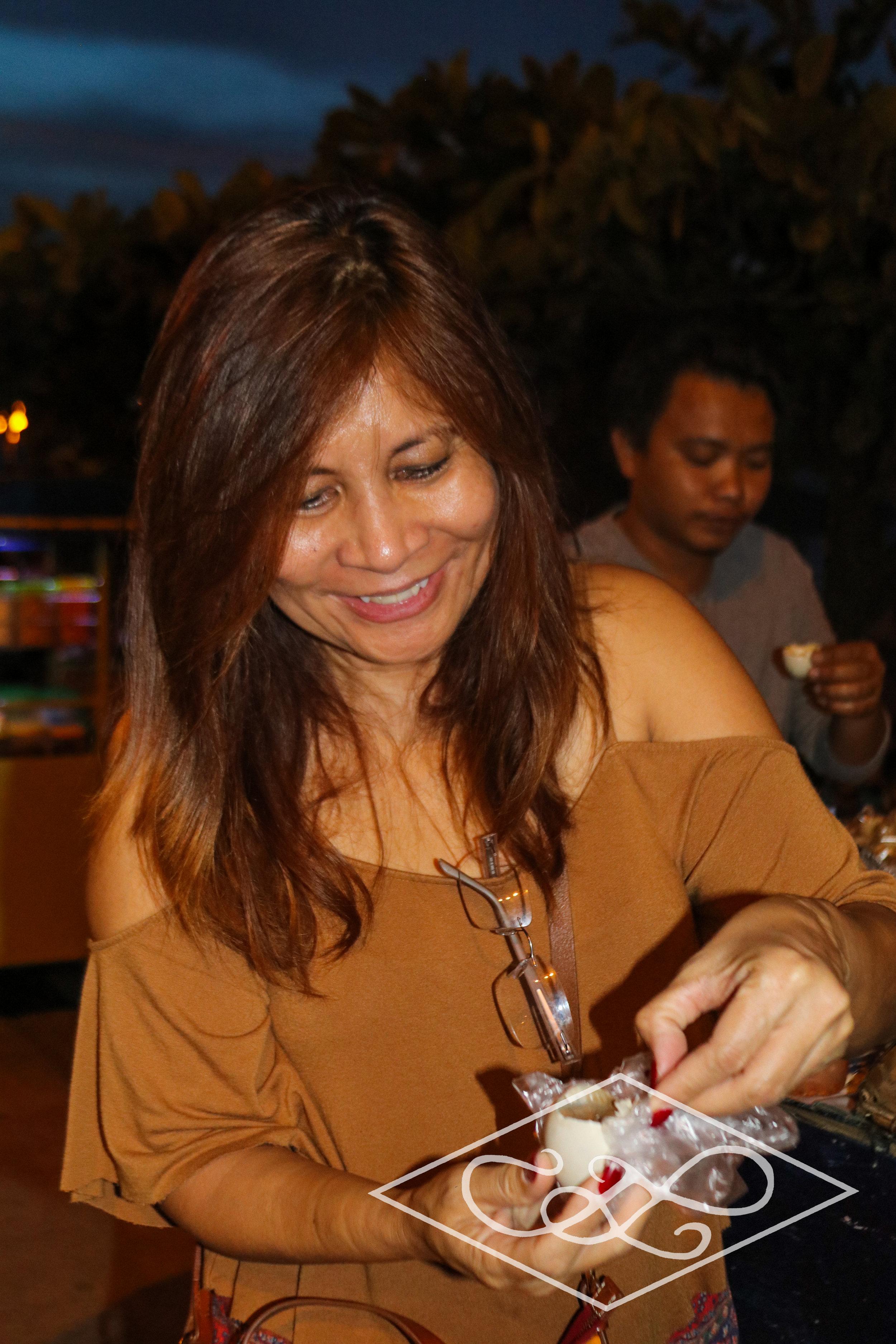 Dina having Balut
