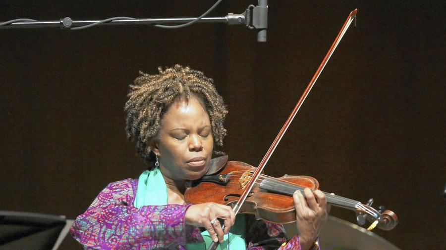 Regina Carter, shown here at the University of Chicago's Logan Center for the Arts on Friday Oct. 24, 2014. Carter will play with pianist Xavier Davis to close out the first night of the ninth annual Hyde Park Jazz Festival. (Armando L. Sanchez / Chicago Tribune)