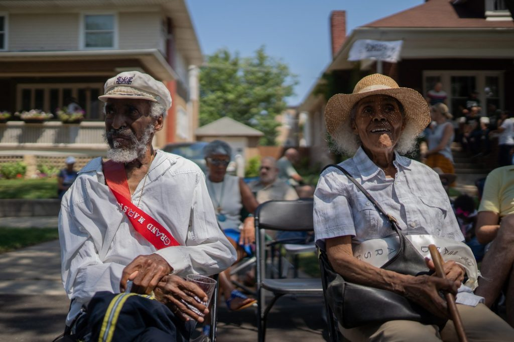 Jimmy Ellis, grand marshal of Back Alley Jazz, listens to music with his wife, Joan. Jimmy Ellis, who worked with legends like Nat King Cole, Sun Ra and other big names in the jazz scene, was one of the people who started live jazz in back alleys.