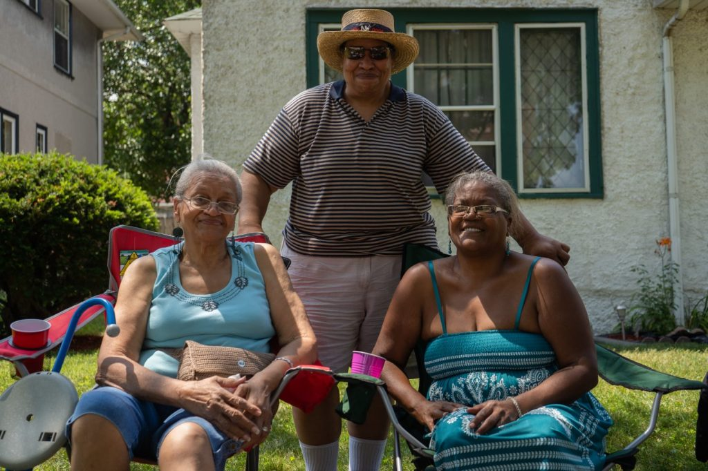 "Two generations of Clemmers witnessed jazz in the alley in the '70s and today. ""It's a part of my history. It's a part of my community,"" said Eve Clemmer, center, who is in between her mom and sister."