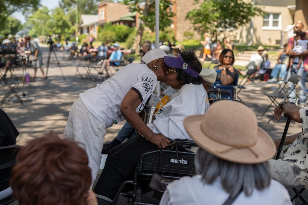 Friends greet each other at Back Alley Jazz Fest in South Shore.