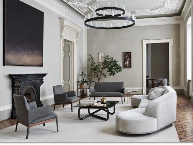 Arcolor sofa and Hug armchair by Arflex
