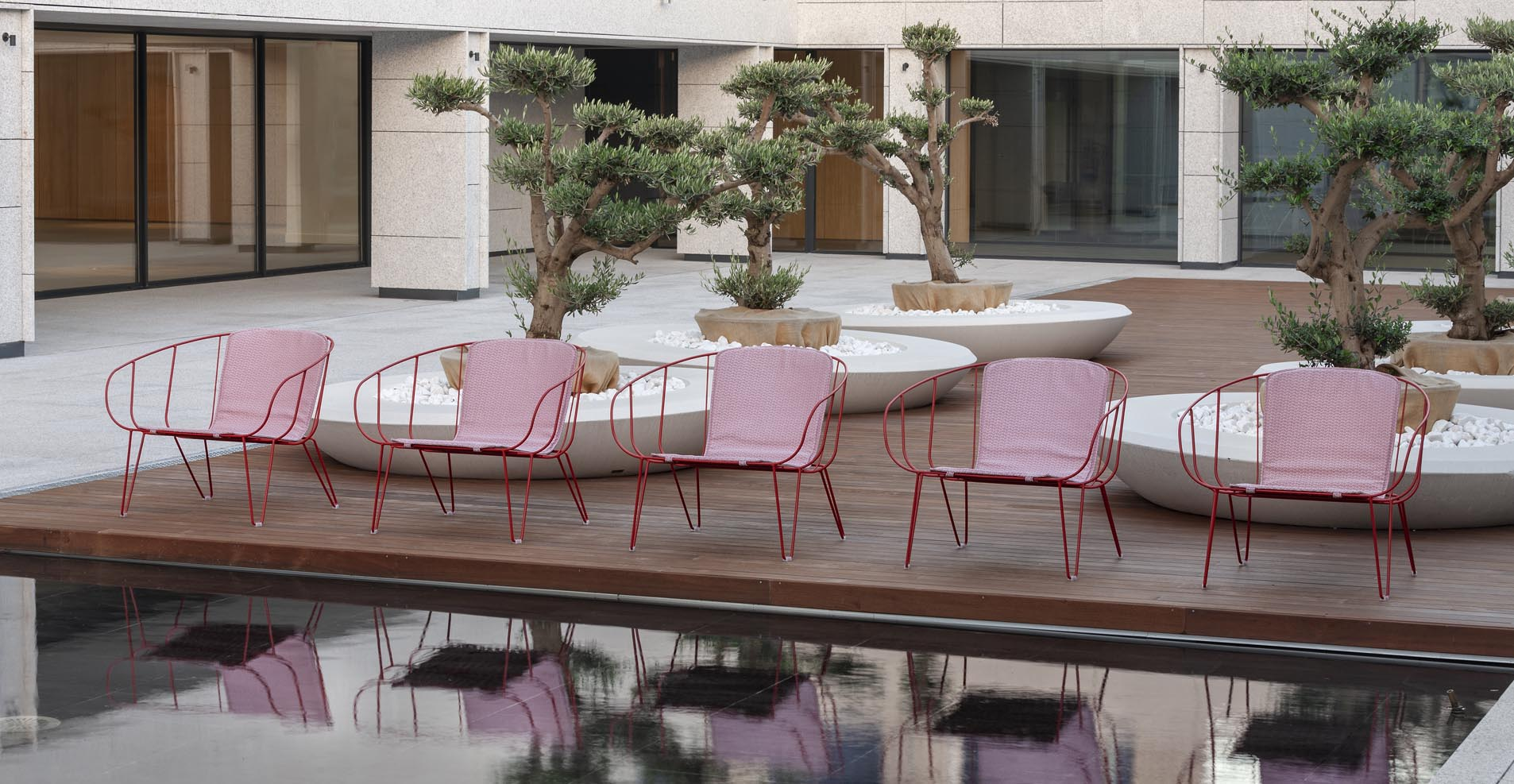 Olivo Lounge for Isimar is a stacking outdoor lounge chair