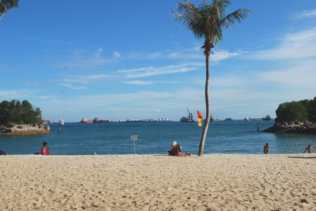 Sentosa -Beach bars, tourist attractions and shipping lanes on the horizon