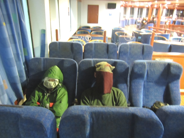 Trying to sleep on the ferry. Of course we could have rented a cabin but that seemed far too sensible!
