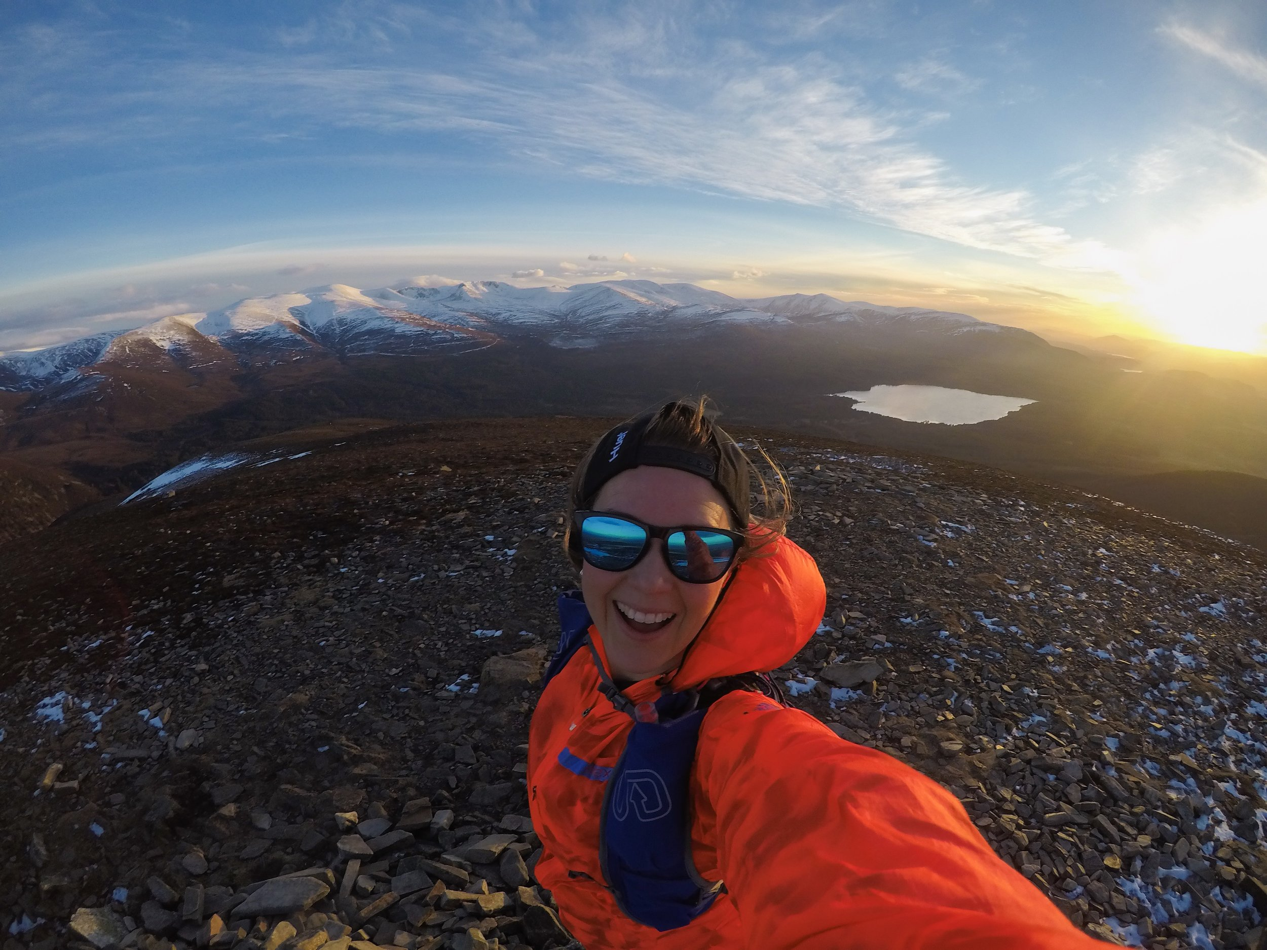Running up mountains at sunset in the Cairngorms, Scotland