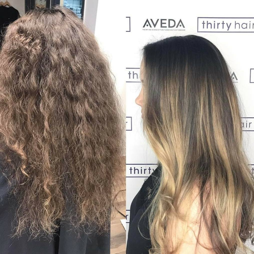 Virgin, curly hair taken to a soft blonde balayage