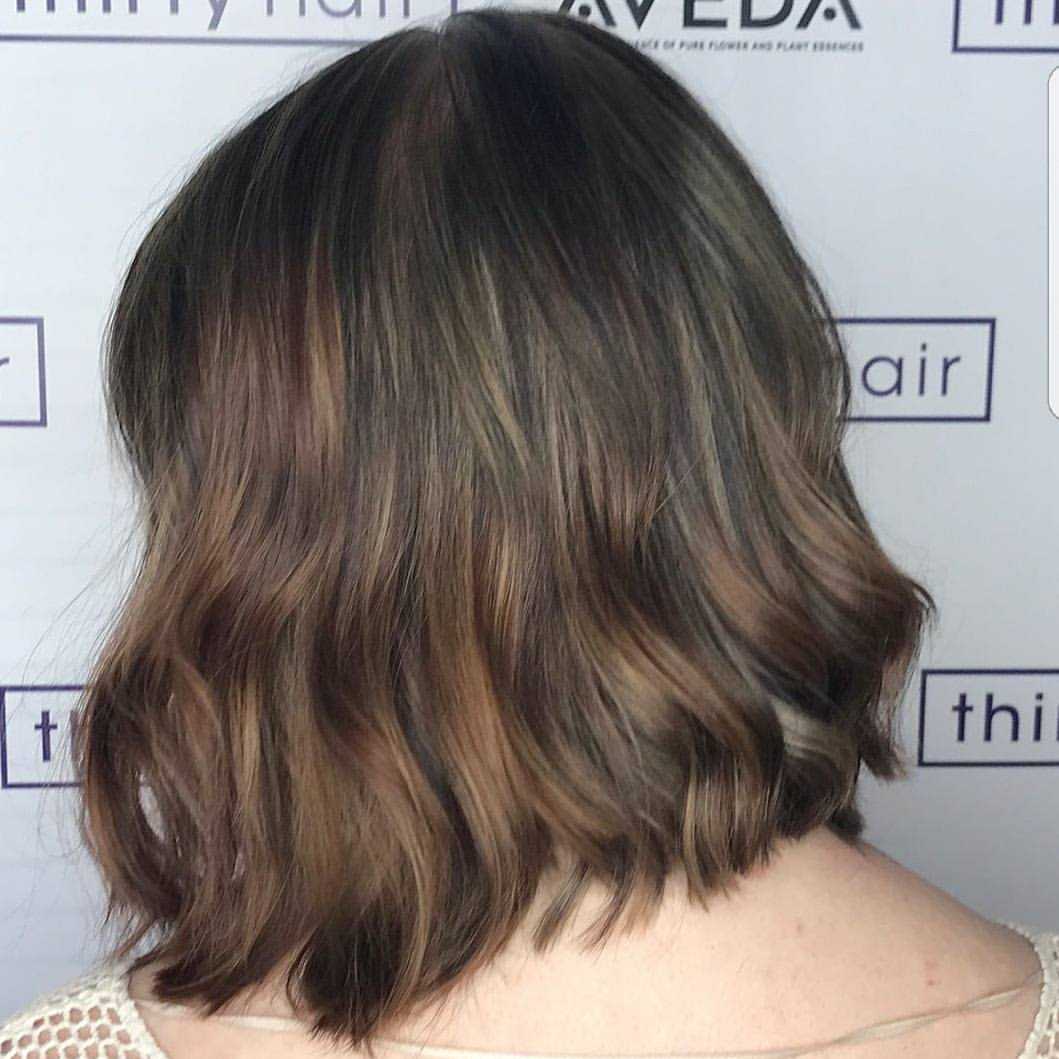 Black box color softened up with a full dimensional foil and toned to a cooler light brown