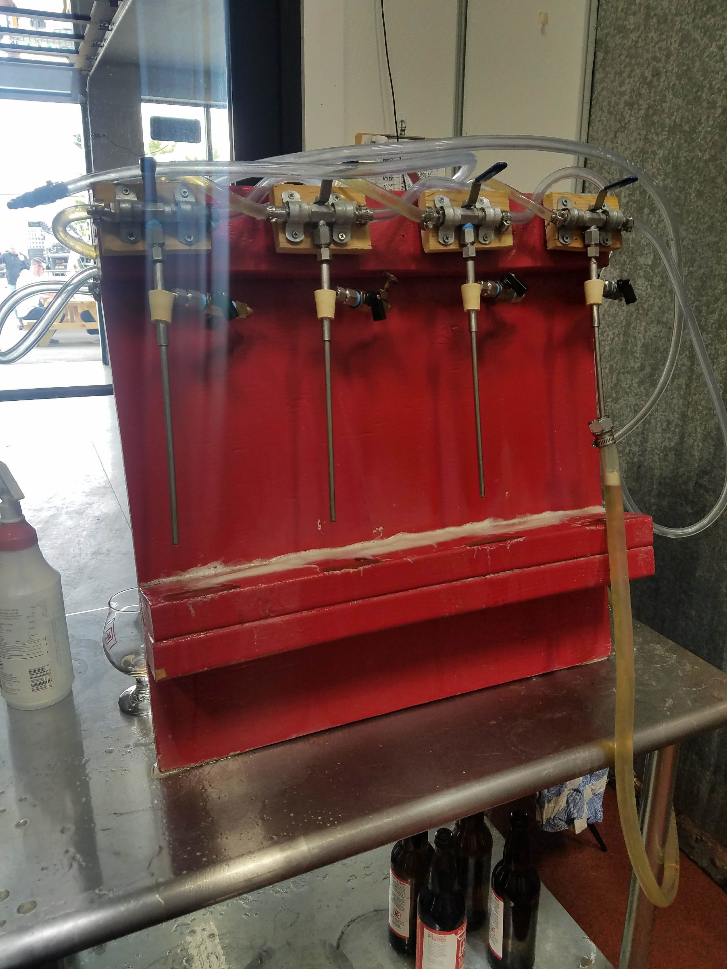 Barry's insane hand made bottle filler can fill 4 bottles at a time