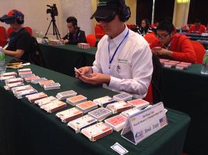 Memorizing 13 decks of cards in one hour at the World Memory Championships in China, 2014.