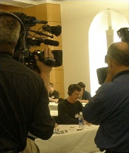 Cool under the pressure of television cameras filming at a competition in the United States.