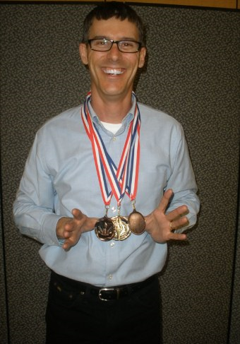 Brad with medals from one of the USA competitions.