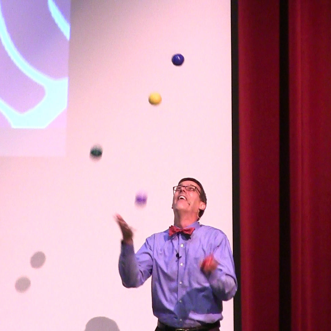 Juggling five beanbags to visually demonstrate how attention affects memory.