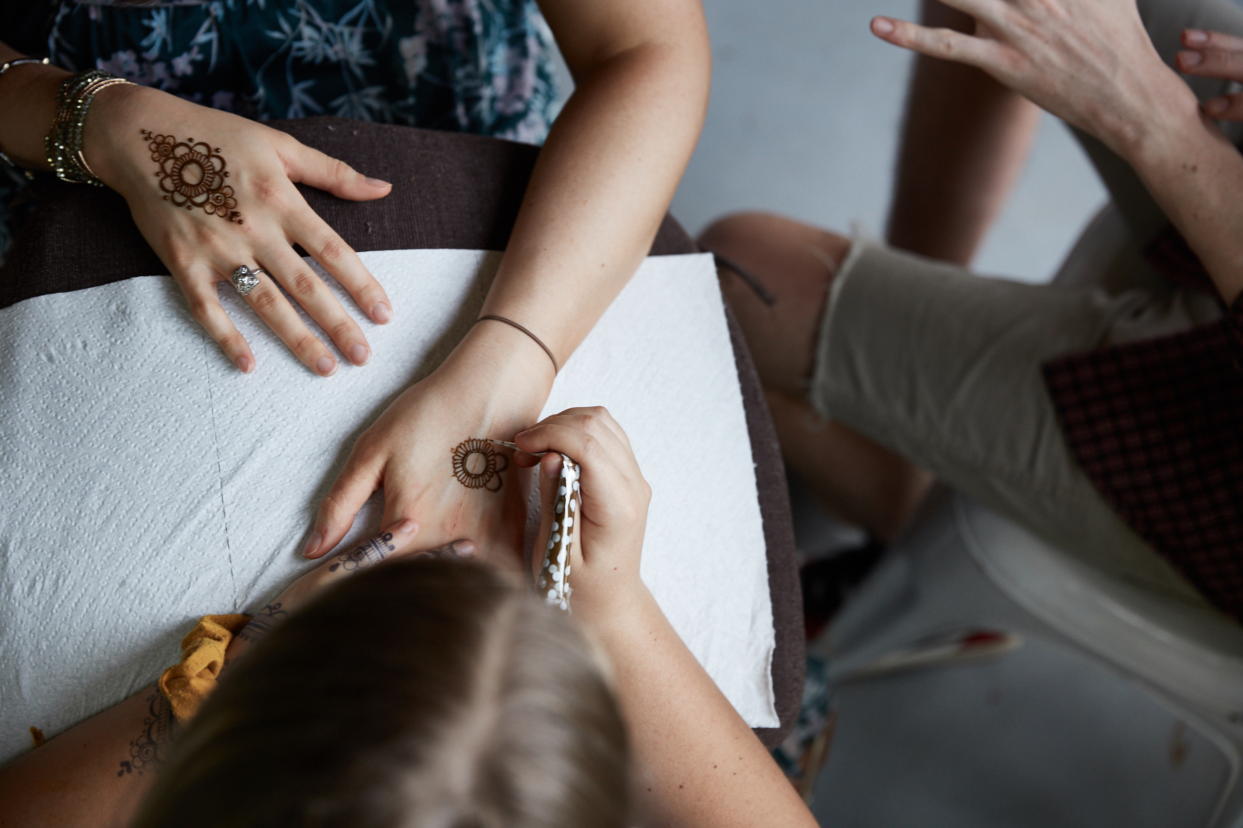 A bridesmaid getting henna. Photo by Emily Nichole Photography.