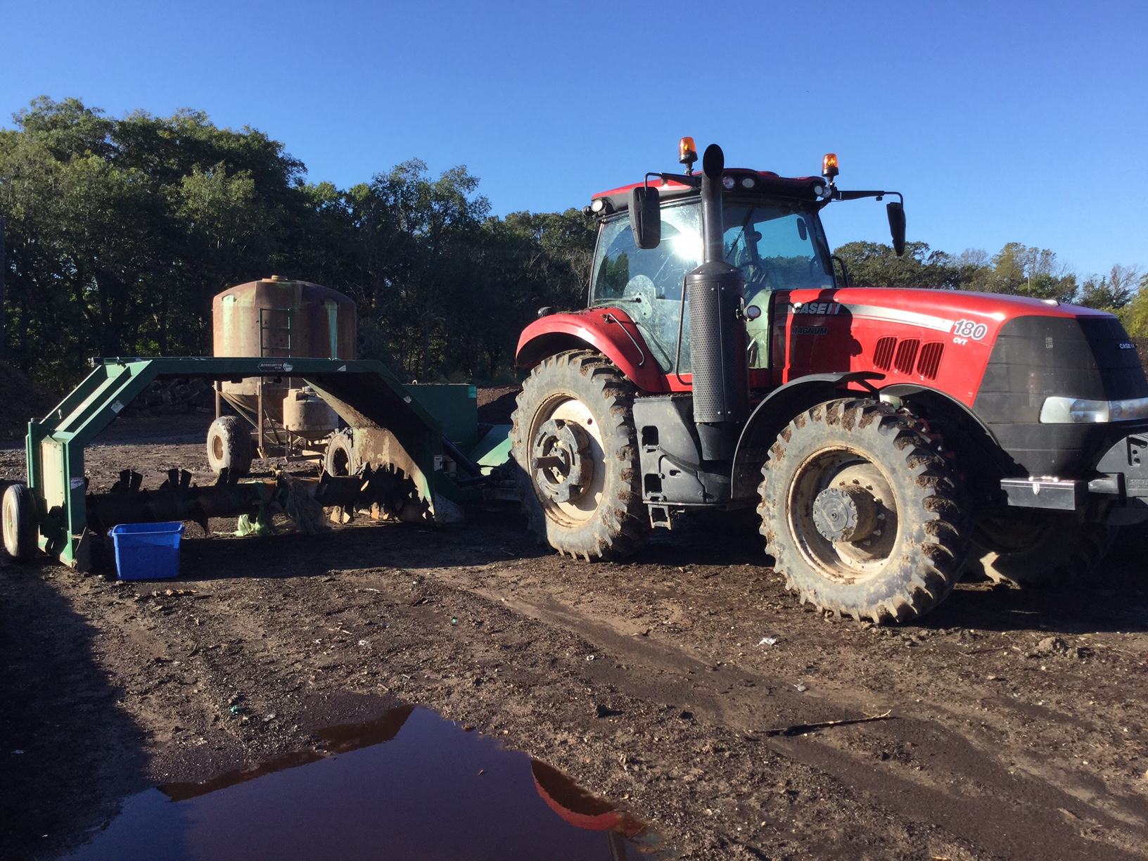 Tractor, Turner, and Water Wagon. This lets us turn about 300 yards of compost in just a few minutes. The water wagon holds 1700 gallons of water that spray from nozzles just above the turner blades so that the compost is evenly moistened when necessary..