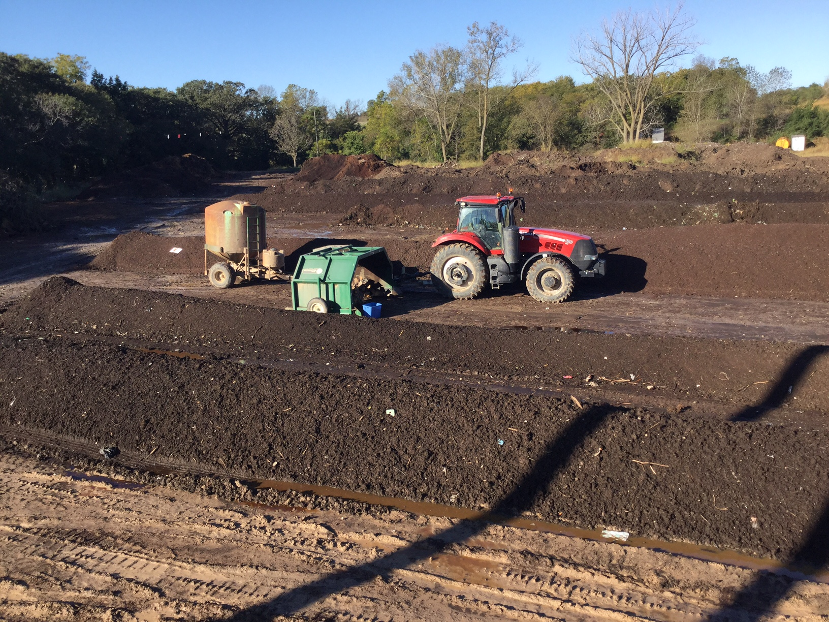 """In its natural habitat, this shepherd of compost sleeps with the flock. Piles are 12 feet wide by up to 300 feet long. That's as much as 400 yards per """"windrow""""."""