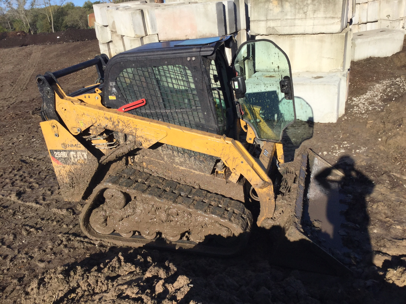 Last but not least (except in size) the skid-steer. This is a familiar one, it can zip around, carry modest loads, it can hold a fork lift or a bucket, I use it to shave off the edges of windrows if they're too wide. It has the most variety of uses, like a swiss army knife.