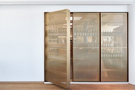 Beverage storage by Retail Architects and Årstiderne Arkitekter