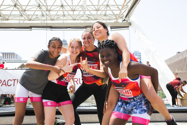 """BTST female students taking center stage at the Wrestle the North """"Girl's Edition"""" wrestling event at Nathan Phillips Square July 2018."""