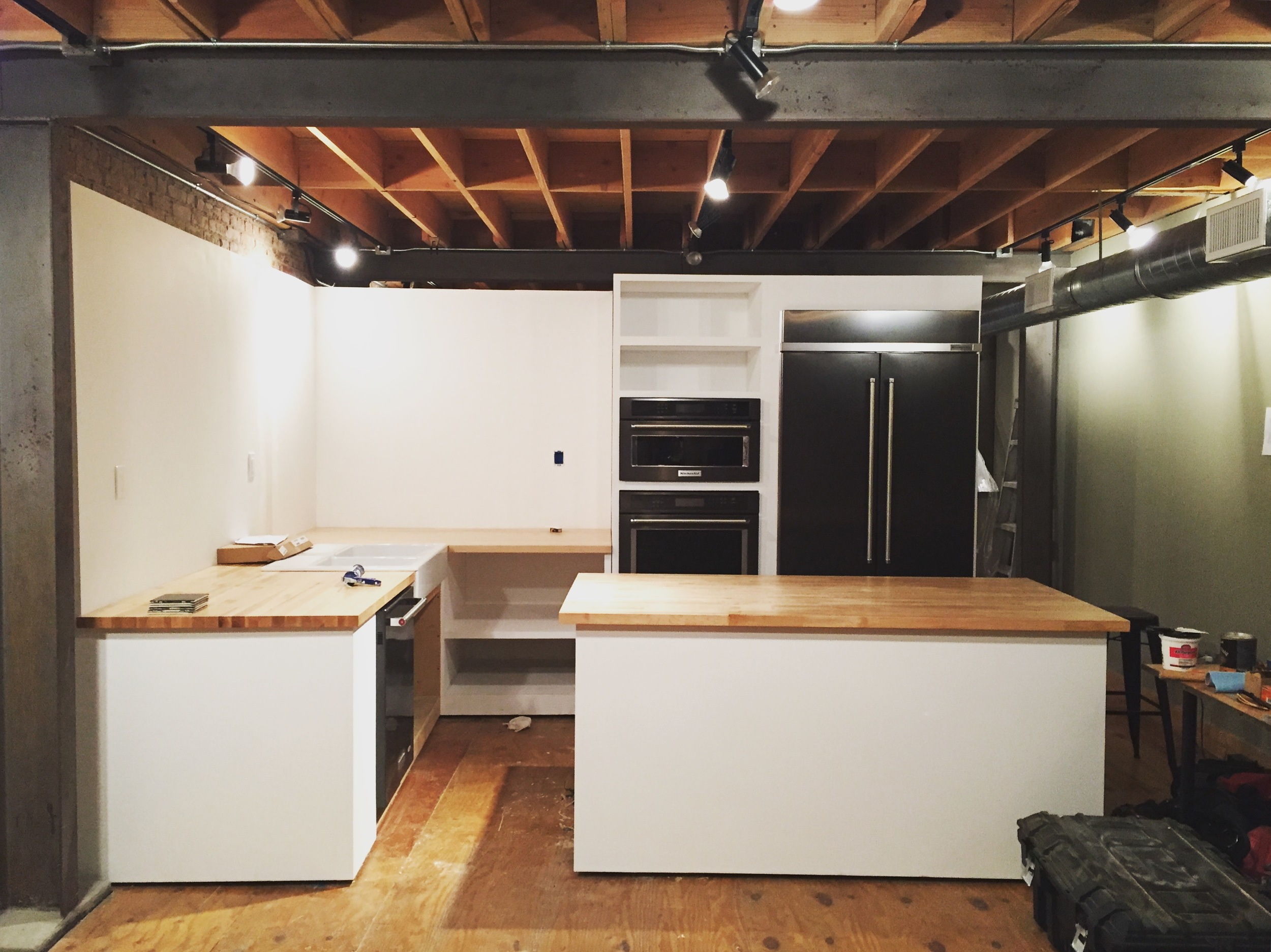"""Day Four: 1 1/2"""" hard maple tops cut, glued up and placed, sink and appliances installed, paint applied."""