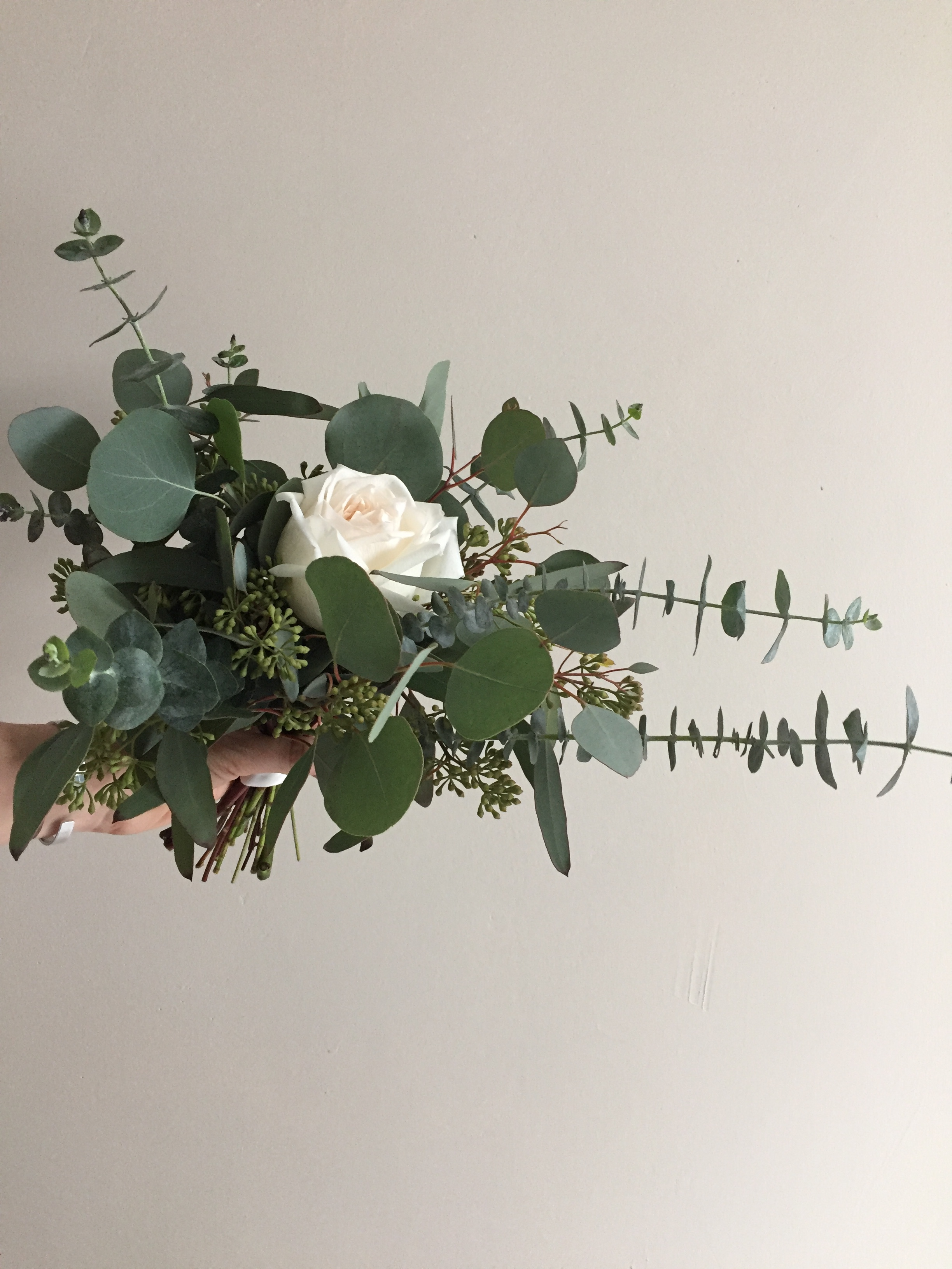 The perfect petite bouquet for the maids! Filled with three kinds of eucalyptus and a single gorgeous rose.