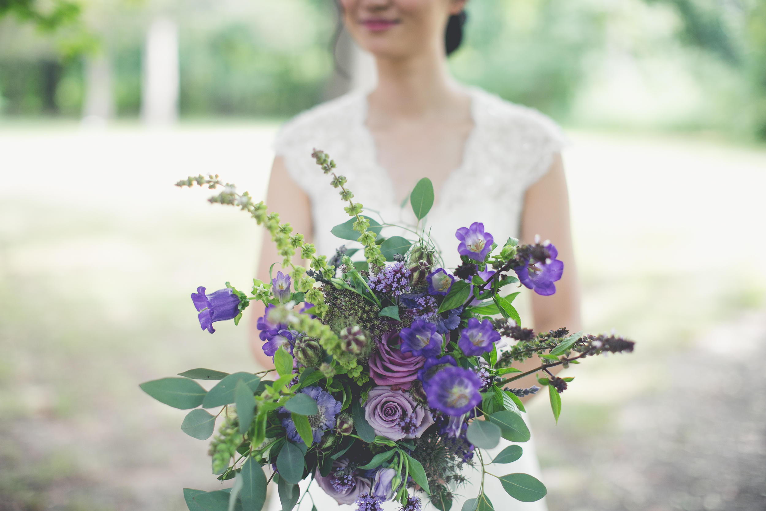 Shades of lavender with roses, campanula, flowering basil, eucalyptus, scabiosa and nigella pods.