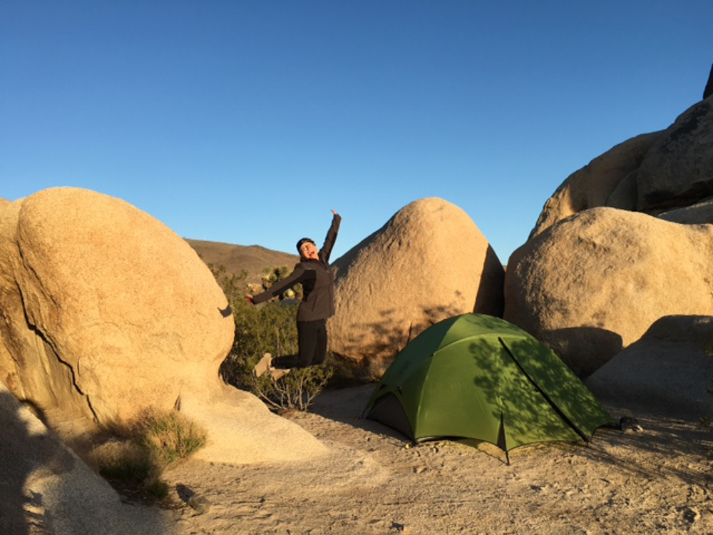 Stephanie at her solo campsite in Joshua Tree