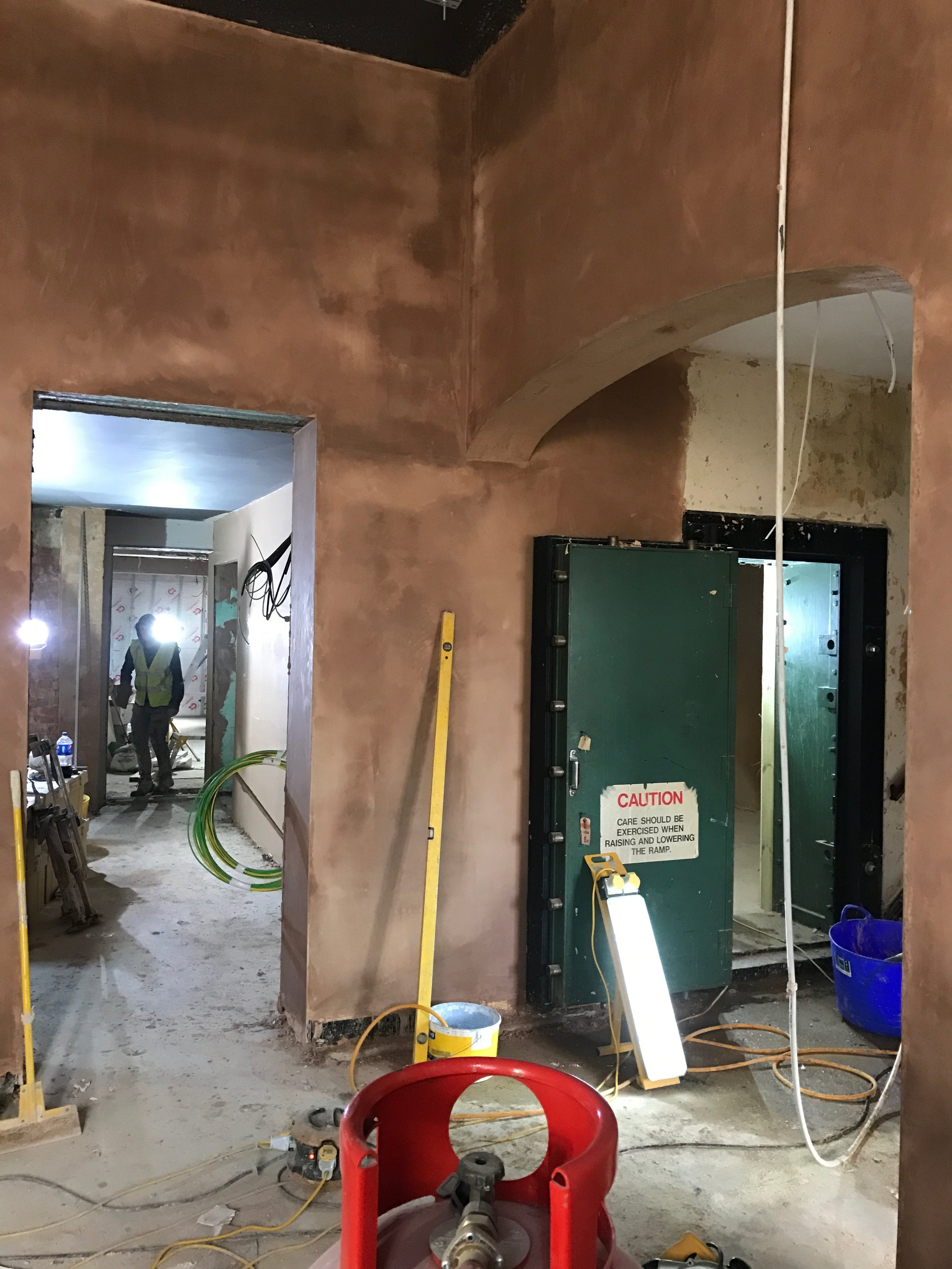 Re-plastering continues whilst other trades push on to meet our looming completion date.