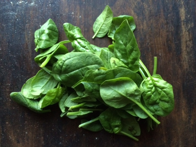 spinach leaves on desk.JPG