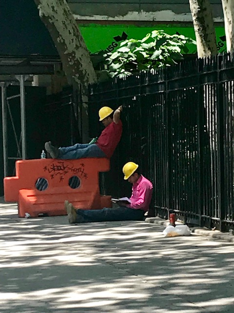 These guys looked like they were hired actors to play construction workers taking a break! It made me happy to see them slowing down too.