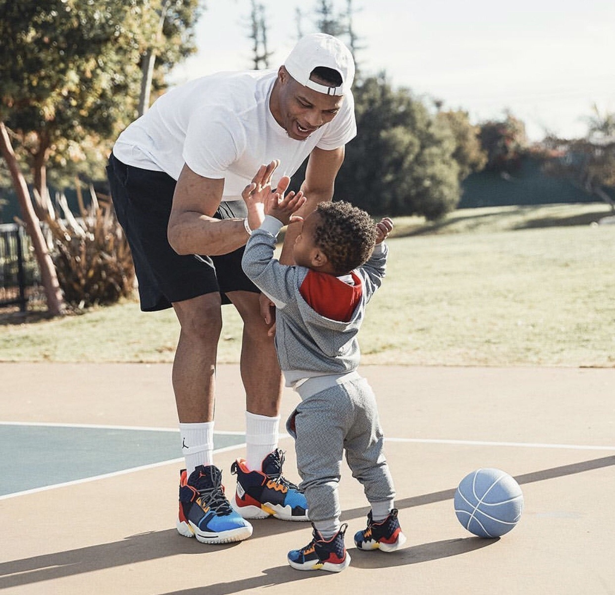 Russell and his son, Noah in the new Why Not 2.0 sneakers.