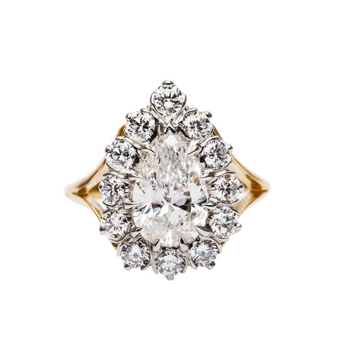 Kip's Bay  is a show-stopping handmade platinum and 18k yellow or rose gold engagement ring featuring a delightful pear shaped diamond of your choice. Modeled after our original Victorian era ring, the Kip's Bay can feature a 0.75ct to a 2.50ct Pear cut diamond center.