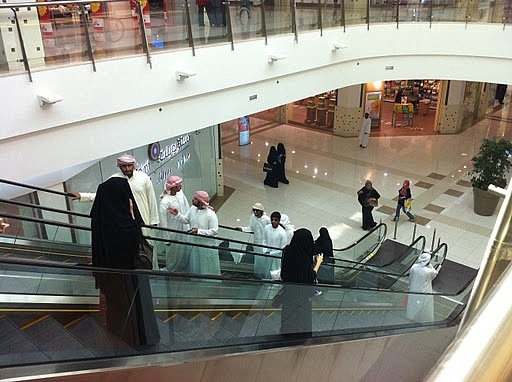 A mall like any other, only shoppers dressed differently.  Shoppers are shoppers.