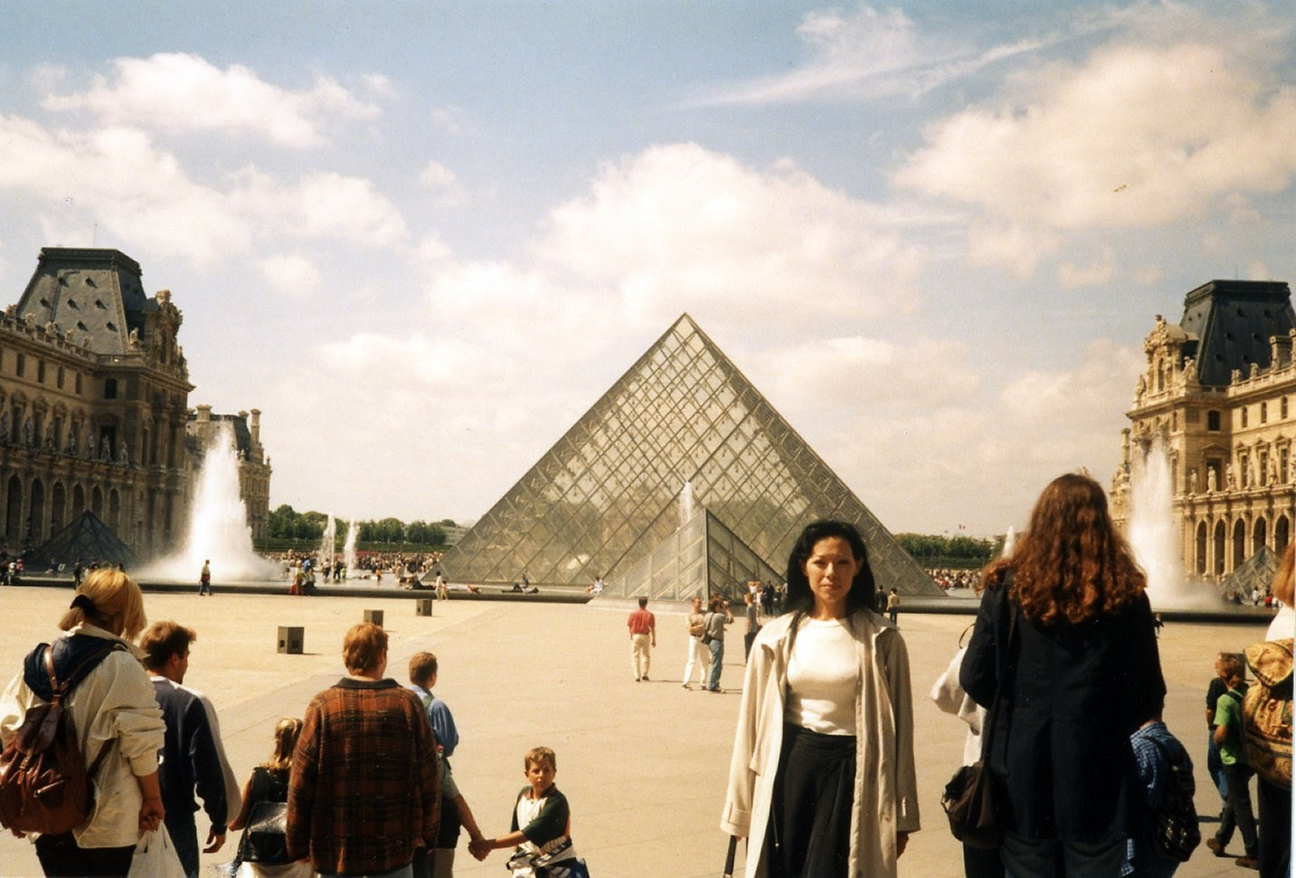 Yes, I look angry…I'm actually exhausted…but about to go into the pyramid to buy tickets to the Louvre Museum!