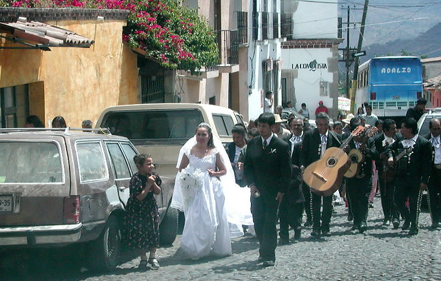 Traditional Mexican wedding where the Bridge walks to the church accompanied by music and her family.