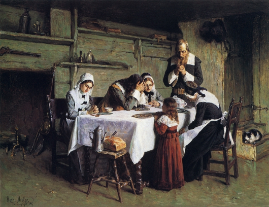 A Christian family at mealtime.