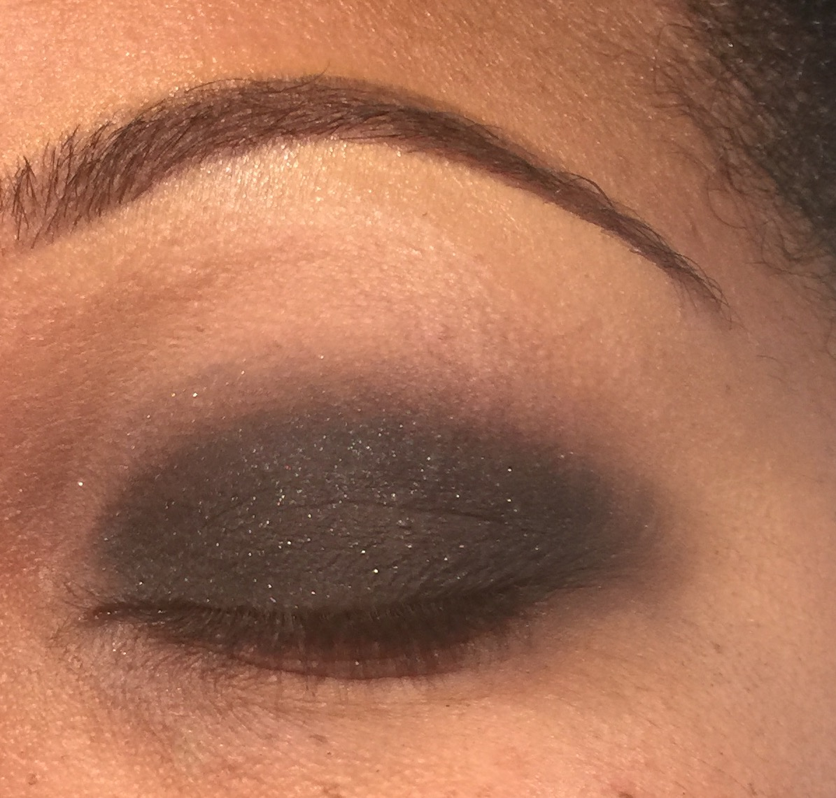 Step Three: Take a black eyeshadow and pack it on to your lower lid. Again its ok if its not neat, step four will take care of that. Again, just be sure not to go too far past your crease.  I used MAC Cosmetics Eyeshadow in Carbon.  Keep adding black shadow until you reach your desired intensity.