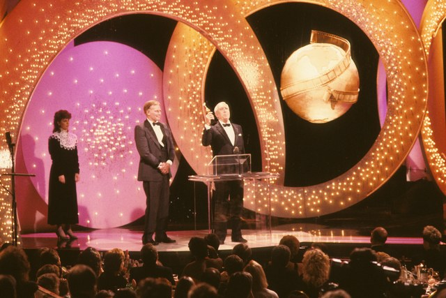 Set design (and background neck doily) Golden Globes circa 1987 via architecturaldigest.com
